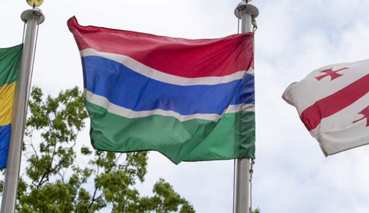 The flag of the Islamic Republic of the Gambia (centre) flying at United Nations headquarters in New York.